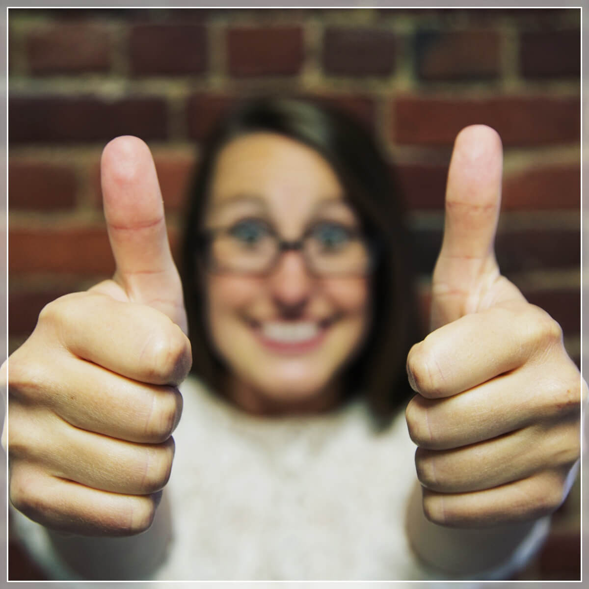 Woman giving two thumbs up to the camera