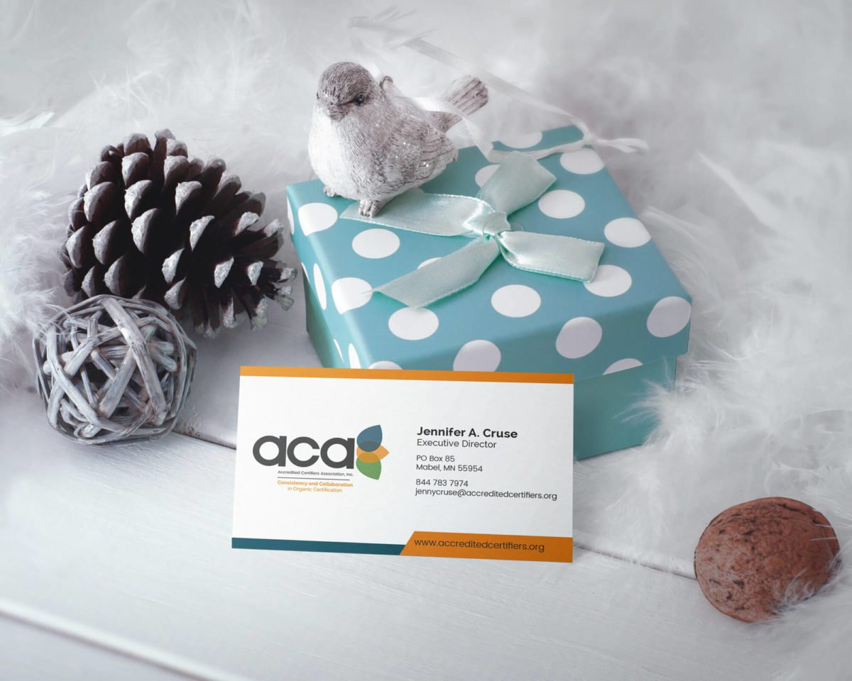 Accredited Certifiers Association Business Card with present and feathers