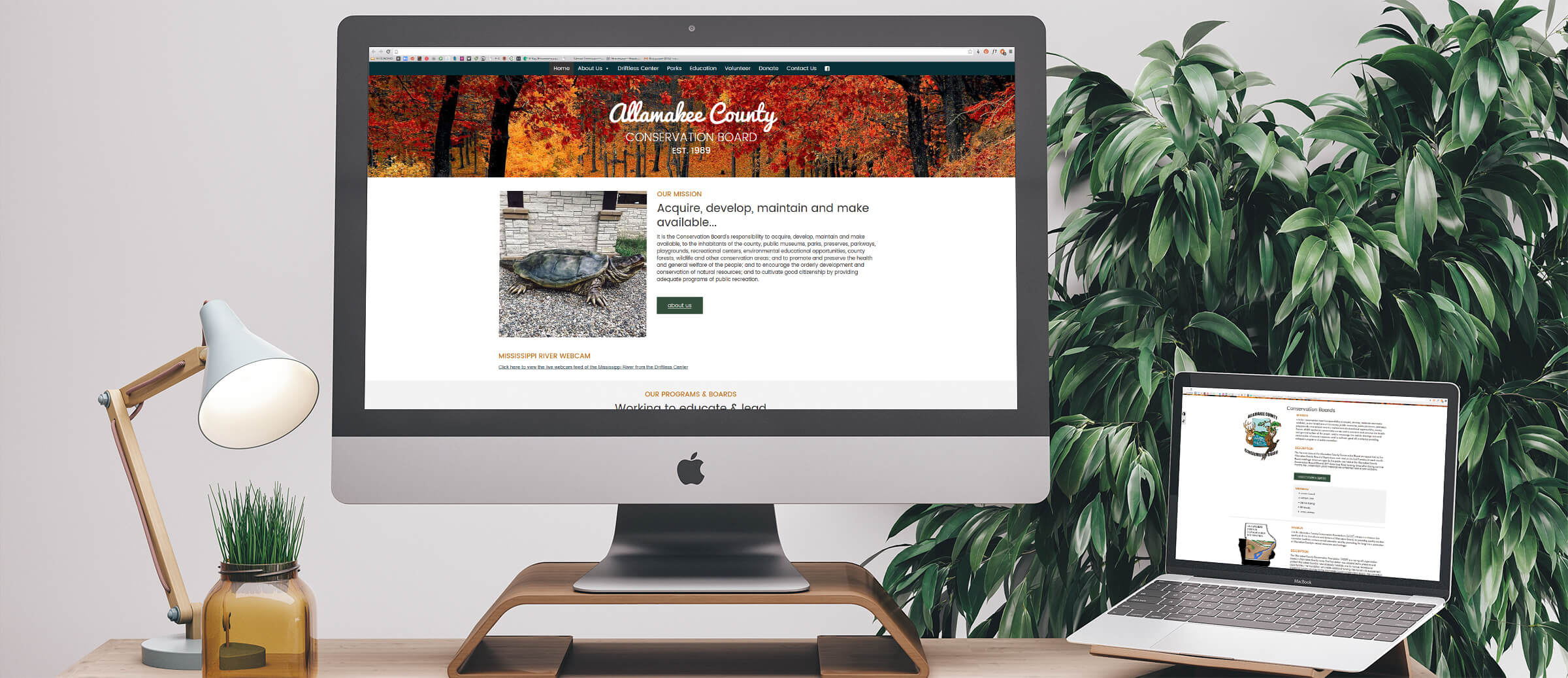 Allamakee County Conservation Board's website on computer and laptop