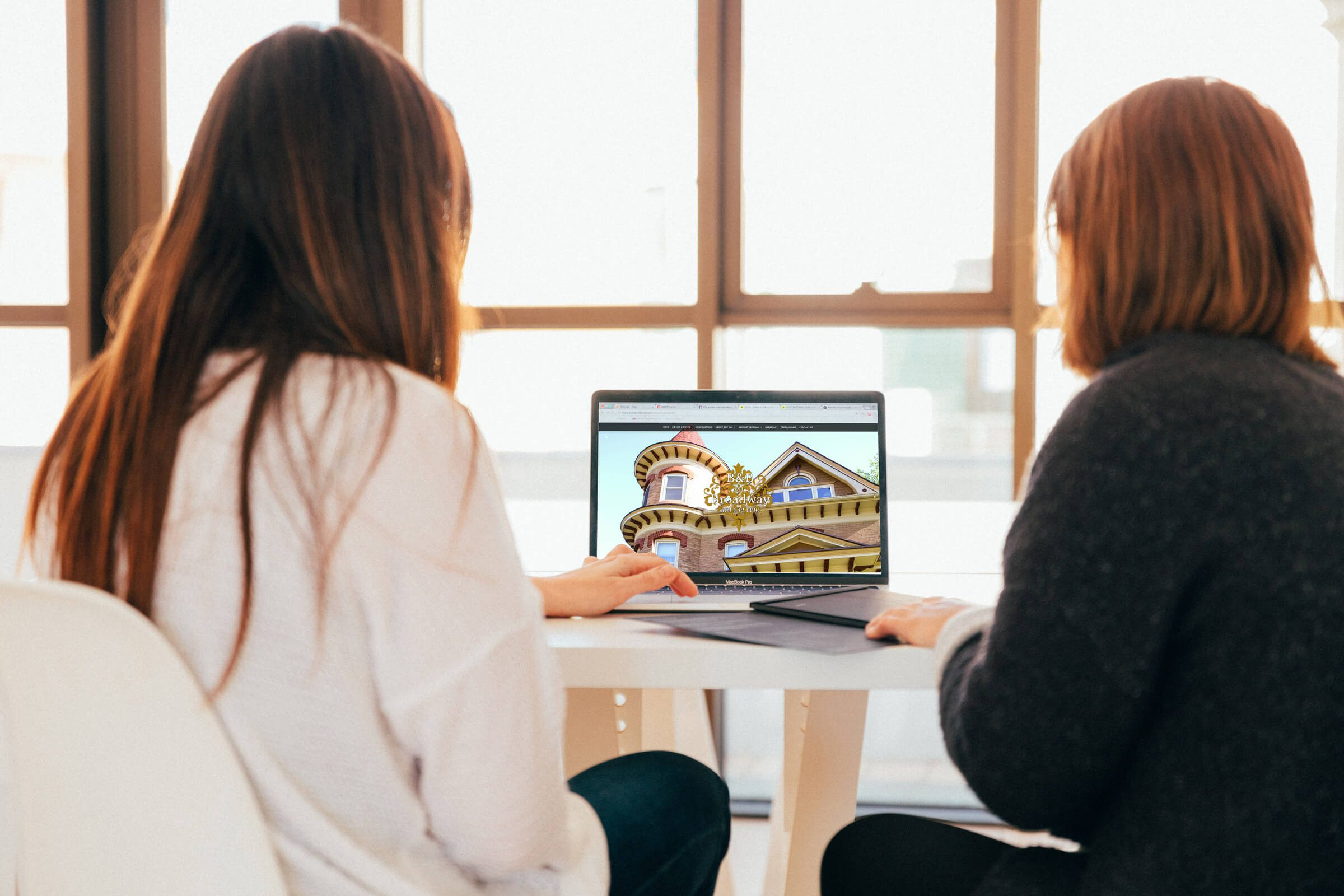 B&B on Broadway website on laptop with woman