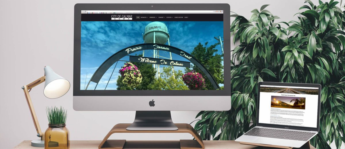 City of Calmar's website on computer and laptop