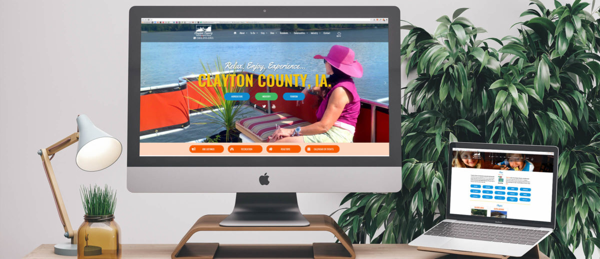 Clayton County's website on computer and laptop