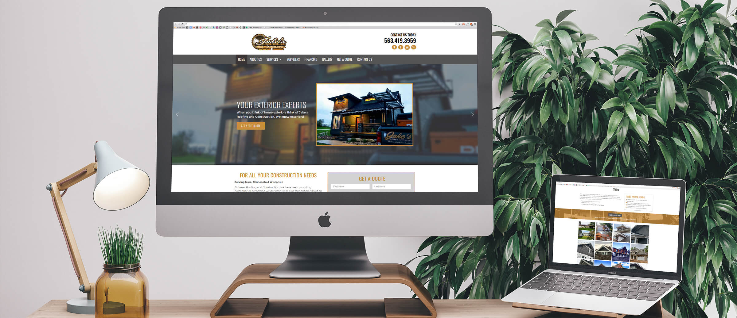 Jake's Roofing & Construction's website on computer and laptop