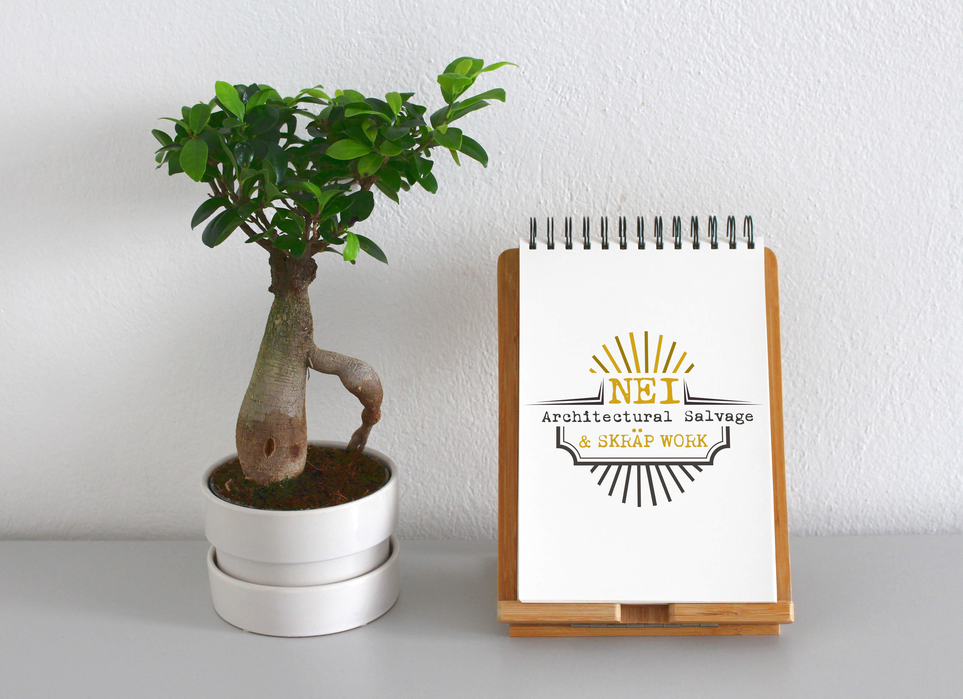 NEIA & Skräp Work logo on notepad with tree