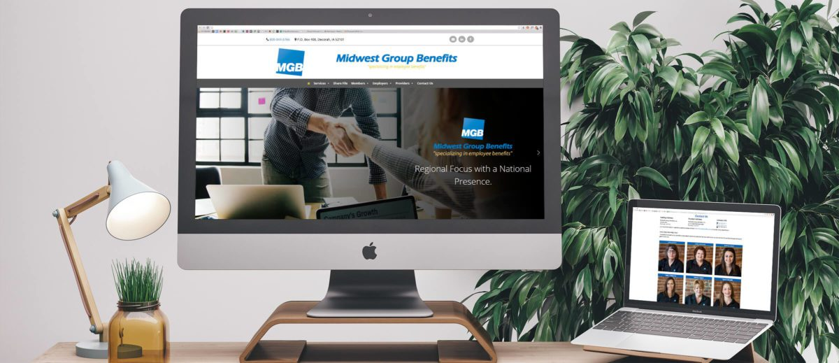 Midwest Group Benefits' website on computer and laptop